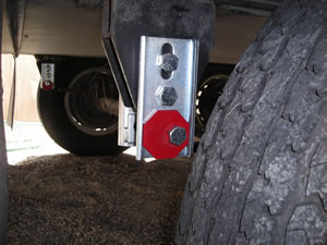 Pass Rear - Red octagon cam rotated for 1/2 inch forward adjustment of axle